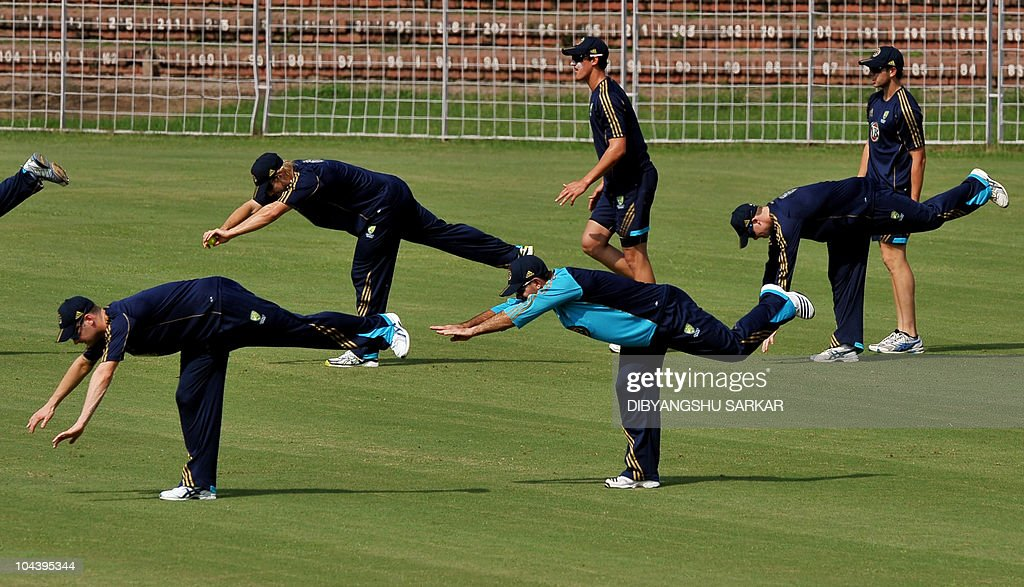 Australian cricket captain Ricky Ponting with deputy captain Michael Clarke and teammates warm up during a training session in Chandigarh on...