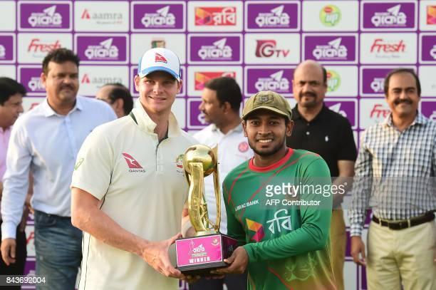 Australian cricket captain Steven Smith and Bangladeshi cricket captain Mushfiqur Rahim hold the tournament trophy during the presentation ceremony...