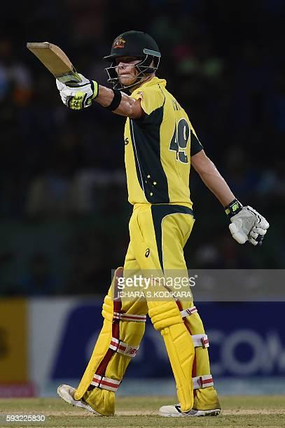 Australian cricket captain Steven Smith celebrates 50 runs during the first One Day International cricket match between Sri Lanka and Australia at...