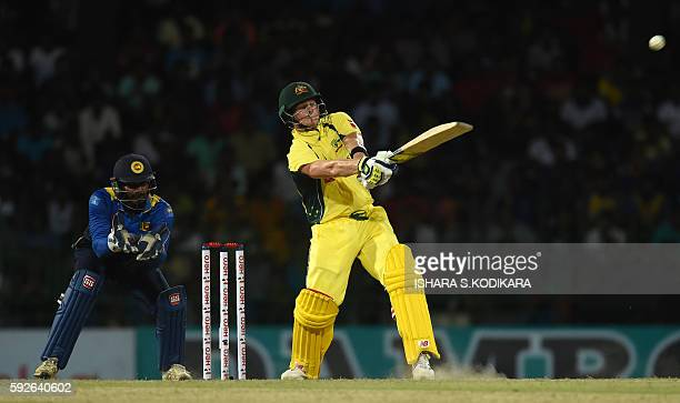 Australian cricket captain Steven Smith plays a shot as Sri Lankan wicketkeeper Kusal Perera looks on during the first One Day International cricket...