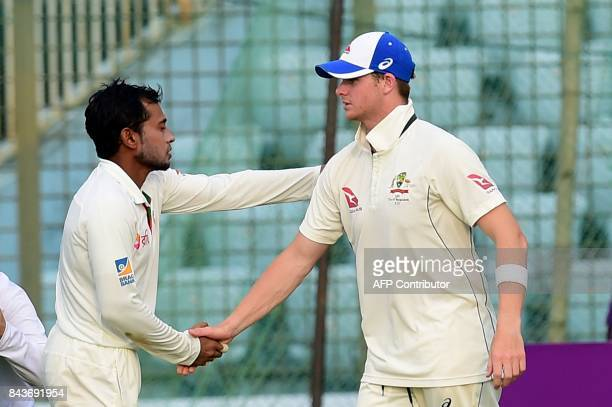 Australian cricket captain Steven Smith shakes hands with Bangladeshi cricket captain Mushfiqur Rahim after winning the second cricket Test between...