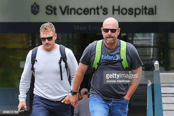 Australian cricket coach Darren Lehmann and Aaron Finch leave St Vincent's Hospital on November 27 2014 in Sydney Australia South Australian cricket...