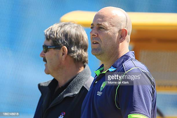 Australian cricket coach Darren Lehmann watches the game during day one of the Sheffield Shield match between the South Australia Redbacks and the...