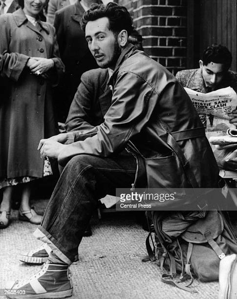 Australian cricket fan Jack Perry waiting outside Lord's cricket ground London before the start of the second Test In the background a man reads a...