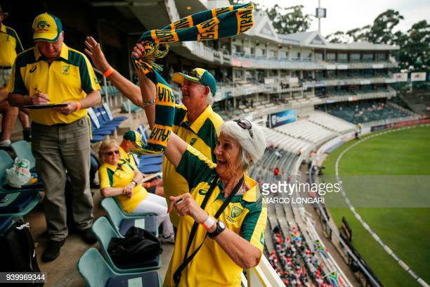 Australian cricket fans cheer ahead of the start of day one of the fourth cricket Test match between South Africa and Australia at Wanderers Stadium...