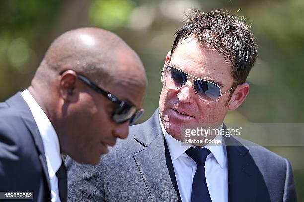 Australian cricket legend Shane Warne and West Indies cricket legend Brian Lara arrive during the Funeral Service for Phillip Hughes on December 3,...