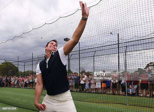 Australian cricket legend Shane Warne bowls to Triple M radio host and Collingwood Magpies President Eddie McGuire in the nets during the Luke Batty...