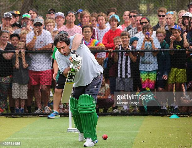 Australian cricket legend Shane Warne bowls to Triple M radio host Mick Molloy in the nets during the Luke Batty Memorial at Tyabb Football Netball...