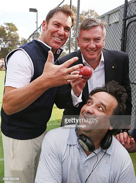 Australian cricket legend Shane Warne poses with Triple M radio hosts Mick Molloy and Eddie McGuire and after injuring a finger when bowling in the...