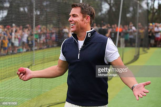 Australian cricket legend Shane Warne reacts after bowling to Triple M radio host Mick Molloy in the nets during the Luke Batty Memorial at Tyabb...