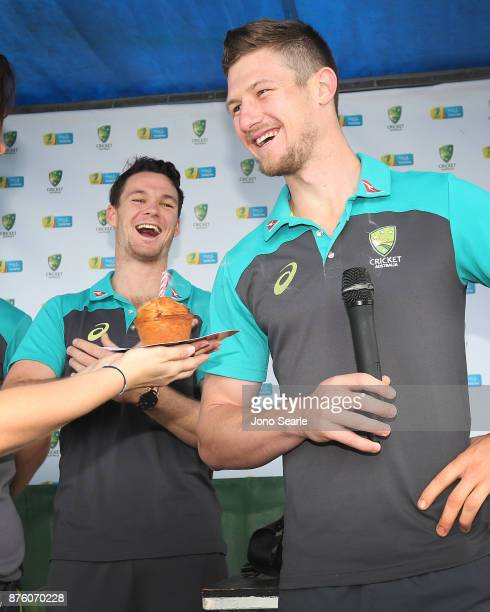 Australian Cricket player Cameron Bancroft smiles as he is wished happy birthday as team mate Peter Handscomb looks on as they attend the Brisbane...