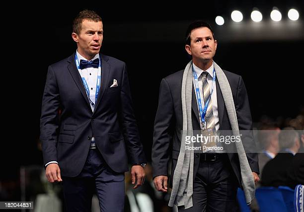 Australian Cricket player Peter Siddle and Former Australian Cricket player Ricky Ponting arrive for the 2013 Blackwoods North Melbourne Grand Final...