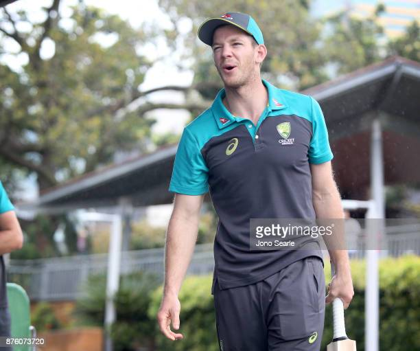 Australian Cricket player Tim Paine reacts after he hits a ball as he attends the Brisbane Bupa Family Day on November 19 2017 in Brisbane Australia