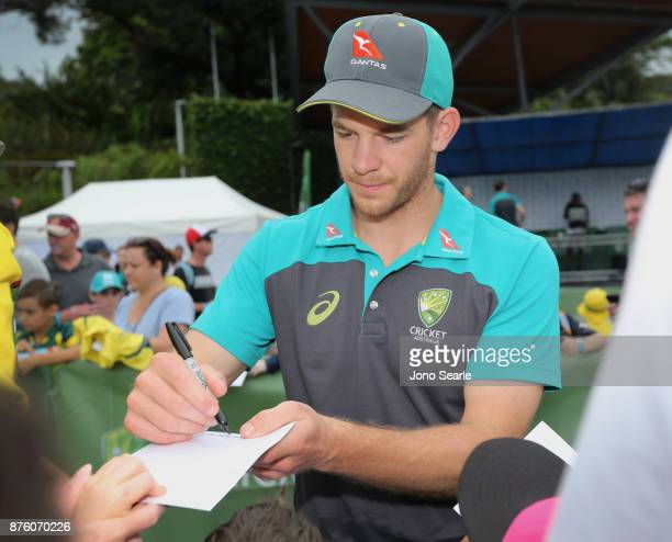Australian Cricket player Tim Paine signs autographs for fans during the Brisbane Bupa Family Day on November 19 2017 in Brisbane Australia