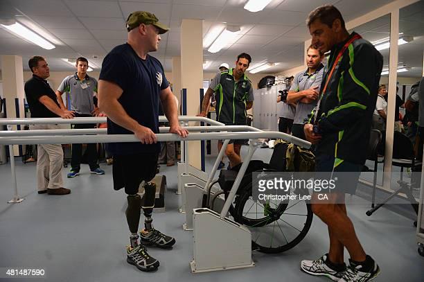 Australian cricket player's Josh Hazelwood Mitchel Johnson and Ryan Harris talk to James Wilson as they visit Headley Court Military Rehabilitative...