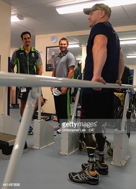 Australian cricket player's Mitchel Johnson and Ryan Harris talk to James Wilson as they visit Headley Court Military Rehabilitative Centre on July...