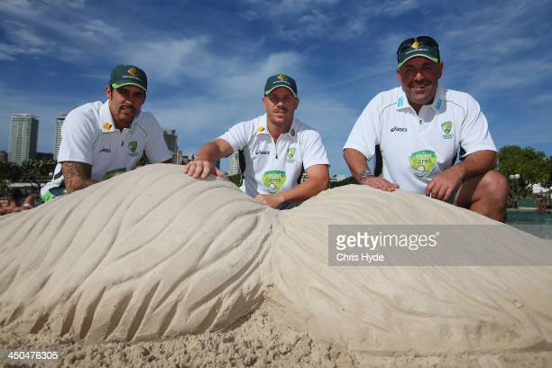 Australian Cricket players Mitchell Johnson and David Warner and Australian coach Darren Lehman pose with the sand Mo at Southbank during the Cricket...