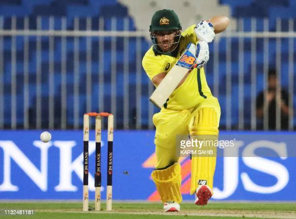 Australian cricketer Aaron Finch plays a shot during the second one day international cricket match between Pakistan and Australia in Sharjah in the...