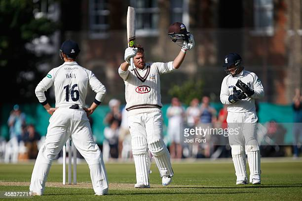 Australian cricketer Aaron Finch salutes the crowd after scoring a century on his debut for Surrey during the Specsavers County Championship Division...