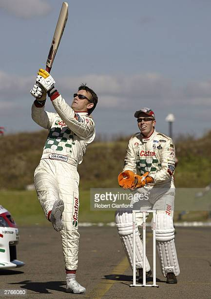 Australian cricketer Adam Gilchrist has a hit as of the Castrol Perkins Race Team looks on prior to practice for the VIP Pet Foods Main Event which...