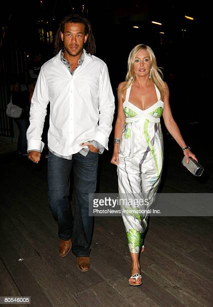 Australian cricketer Andrew Symonds and his partner Katie Johnson arrive at the engagement party for Lara Bingle and her cricketer boyfriend Michael...