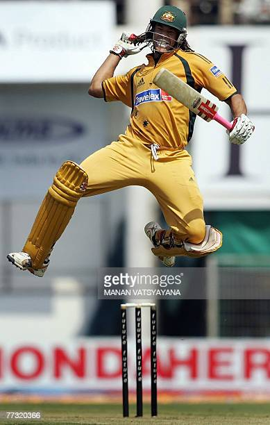 Australian cricketer Andrew Symonds leaps in air as he celebrates after scoring a century during the sixth One-day International match between India...