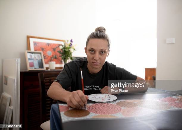 Australian Cricketer Ash Gardiner poses with one of her original paintings at her home on May 08 2020 in Sydney Australia Gardiner tried Australian...