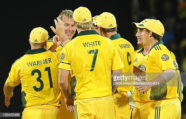 Australian cricketer Brett Lee celebrates with his teammates after he dismissed Sri Lankan batsman Mahela Jayawardene during the first Twenty20 match...