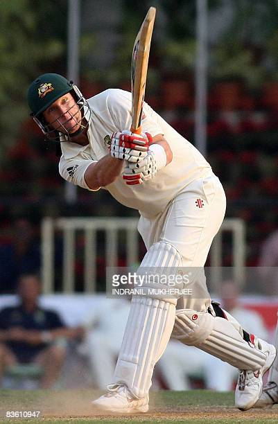 Australian cricketer Cameron White plays a shot on the third day of the fourth and final Test match of the Border-Gavaskar Trophy 2008 series between...