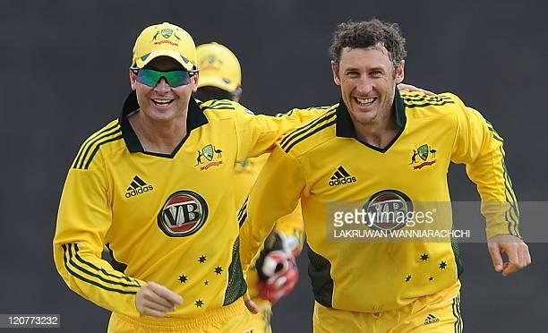 Australian cricketer David Hussey celebrates with his teammates captain Michael Clarke dismissal of unseen Sri Lankan cricket captain Tillakaratne...
