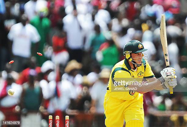 Australian cricketer David Hussey is clean bowled off West Indies bowler Kemar Roach during the third-of-five One Day International matches between...