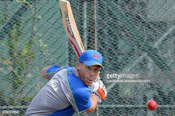 Australian cricketer David Warner bats during a practice session at the P Sara Oval Cricket Stadium ahead of a warmup match in Colombo on July 17...