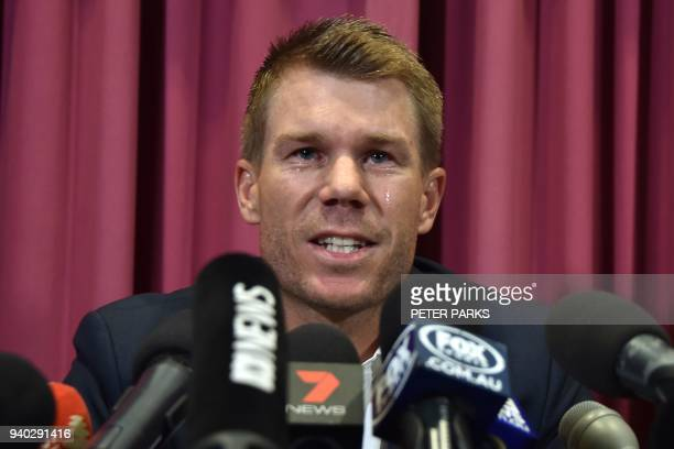 Australian cricketer David Warner cries as he speaks at a press conference at the Sydney Cricket Ground in Sydney on March 31 after his return from...