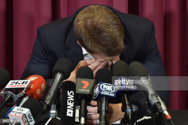 TOPSHOT Australian cricketer David Warner cries during a press conference at the Sydney Cricket Ground in Sydney on March 31 after his return from...