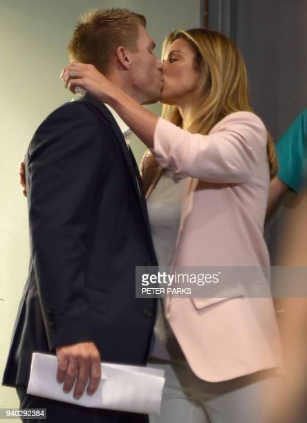 Australian cricketer David Warner kisses his wife Candice as they arrive at a press conference at the Sydney Cricket Ground in Sydney on March 31...