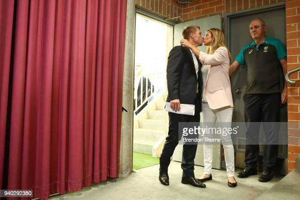 Australian cricketer David Warner kisses wife Candice Warner prior to a press conference to address the media at Cricket NSW Offices on March 31 2018...