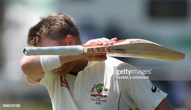 Australian cricketer David Warner leaves the ground after losing his wicket to Sri Lanka's Dilruwan Perera during the third day of the second Test...