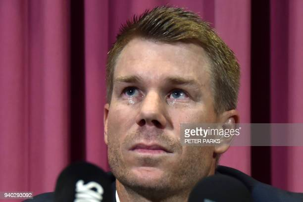 TOPSHOT Australian cricketer David Warner listens to a question at a press conference at the Sydney Cricket Ground in Sydney on March 31 after...