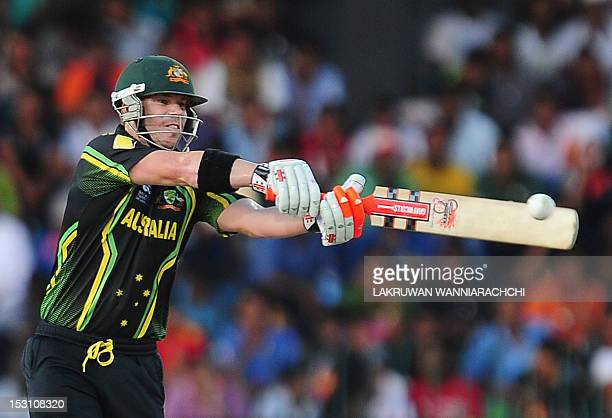 Australian cricketer David Warner plays a shot during the ICC Twenty20 Cricket World Cup's Super Eight match between Australia and South Africa at...