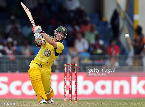 Australian cricketer David Warner plays a shot during the secondoffive One Day International matches between West Indies and Australia at the Arnos...