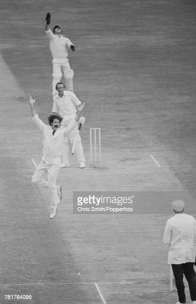 Australian cricketer Dennis Lillee appeals to umpire Dickie Bird for the dismissal of England cricketer Geoff Arnold as wicket keeper Rod Marsh leaps...