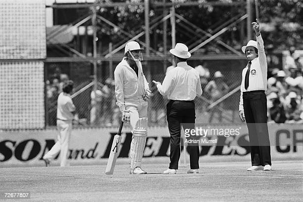 Australian cricketer Dennis Lillee talks to officials about his illegal aluminium bat during the first Test against England at Perth December 1979...
