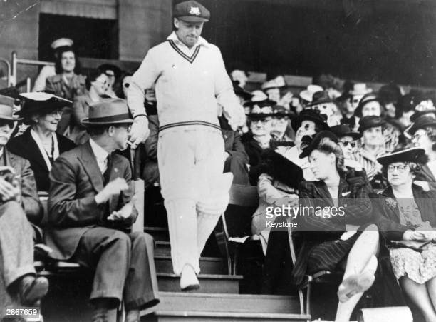 Australian cricketer Don Bradman goes out to bat