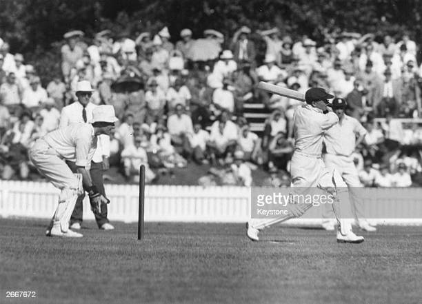 Australian cricketer Don Bradman hits the ball