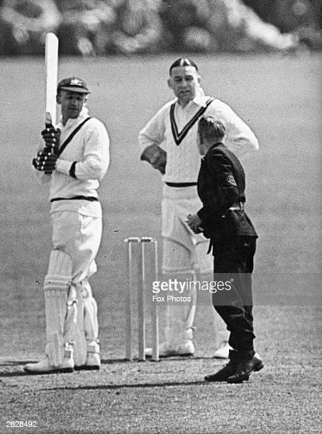 Australian cricketer Don Bradman receiving a telegram on the pitch during a match between Australia and Worcester Original Publication People Disc...