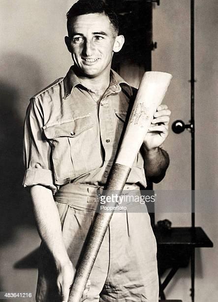 Australian cricketer Jock Livingston with a Samoan cricket bat during Army service circa 1942