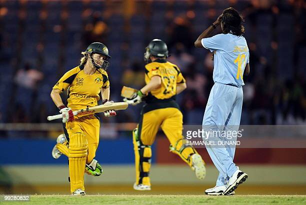 Australian cricketer leah Poulton celebrates with her teammate Jess Cameron take a run as Indian captain Jhulan Goswami looks on during the ICC...
