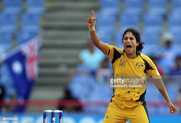 Australian cricketer Lisa Sthalekar celebrates after dismissing Indian Mithali Raj during the ICC Womens World Cup Twenty20 semi final match between...