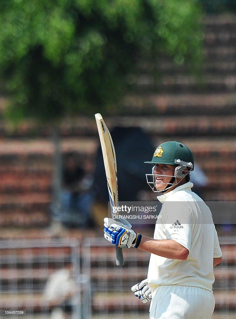Australian cricketer Marcus North gestures after scoring a century during the second day of the threeday practice match between Australia and the...