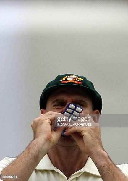 Australian cricketer Mathew Hayden pops a chewing gum into his mouth during their fourday practice match in Hyderabad on October 2 2008 The...